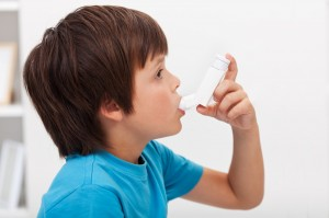 boy with asthma inhaler
